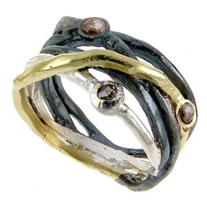 Ring i 925 silver & guldpläterat silver från björg.